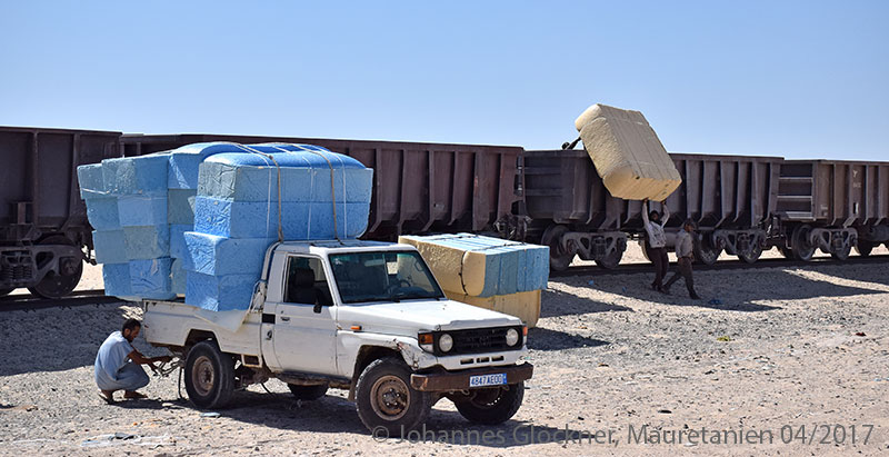 Desert railway in Mauritania loading goods